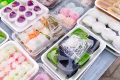 Various Kind of The Thai Traditional Desserts. Assorted Thai Traditional Dessert  and Sweetmeat in Plastic Trays on The Table stock photo
