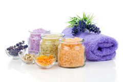 Various kinds of bath salt with flowers Royalty Free Stock Image
