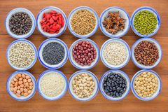 Various kinds of beans and grains ,different kinds of beans and. Various kinds of beans and grains,different kinds of beans and grians in bowl on wooden table stock image