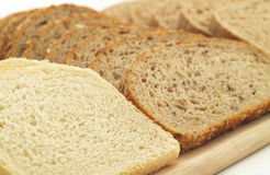 Various kinds of bread. On wooden board Stock Photo
