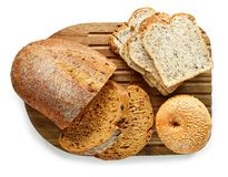 Various kinds of bread on cutting board royalty free stock image