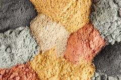 Various kinds of cosmetic clay. Red, yellow, black, blue Royalty Free Stock Images