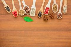 Various kinds of dry herbs dry grains in wooden spoon. Various kinds of dry herbs dry grains in wooden spoon, different kinds of dry herbs in wooden spoon space royalty free stock images