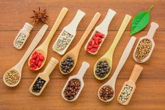 Various kinds of dry herbs dry grains in wooden spoon. Various kinds of dry herbs dry grains in wooden spoon, different kinds of dry herbs in wooden spoon space stock photo