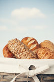 Various kinds of fresh bread. Shallow depth of field. Stock Photos
