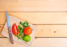 Various kinds of fresh vegetables. For cooking on a wooden chopping board on a wooden floor Stock Photography