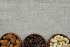 Various kinds of nuts on fabric texture. Abstract image of nuts on fabric texture Stock Photography