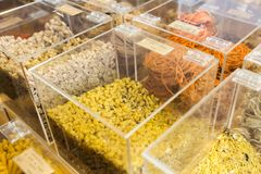 Various kinds of pasta in bulk in an organic store. Stock Photo