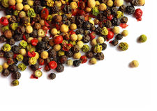 Various kinds  of pepper. Various kinds of seeds of pepper on a white background Stock Photos