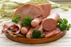 Various kinds of sausages and smoked bacon Royalty Free Stock Photography