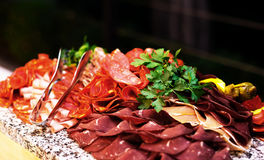 Various Kinds of Sliced Salami on the Plate Royalty Free Stock Image