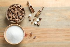 Various kinds of sugar in bowls. On wooden background stock photography