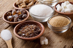 Various kinds of sugar. On a wooden table stock image