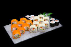 Various kinds of sushi food served on wooden table. Stock Photo