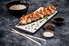 Various kinds of sushi served on black stone stock photo