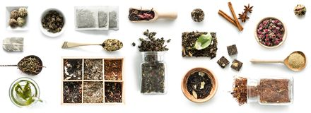 Various kinds of tea, spoons and rustic dishware, brewed green tea, cinnamon. Topview. isolated on a white background Royalty Free Stock Images
