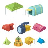 Various kinds of tents and other tourist accessories. The tent set collection icons in cartoon style vector symbol stock. Illustration Royalty Free Stock Photos