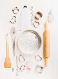 Various kitchen tools selection for easter baking on white wooden background. Top view Royalty Free Stock Photo