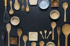 Various kitchen utensils. On black table background Royalty Free Stock Photos