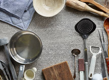 Various kitchen utensils. On gray wooden table, top view Royalty Free Stock Photo