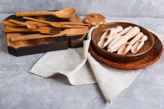 Various kitchen utensils , wicker basket and napkin on the table. stock photo