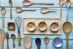 Various kitchen utensils on wooden table background Stock Photo