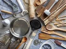 Various kitchen utensils. On wooden table, top view Royalty Free Stock Images