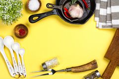 Various kitchen utensils on yellow background. Copy space Stock Photography