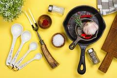 Various kitchen utensils on yellow background. Copy space Stock Photos