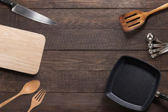 Various kitchenware utensils on the wooden background Stock Photos