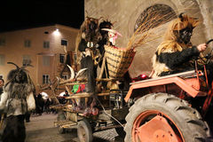 Various Krampus on tractor Stock Image