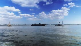 Ships and Boats on New York Harbor. Various large ships and recreational boats on New York Harbor stock footage