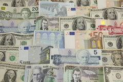 Various layers of International paper money Stock Images