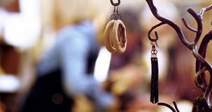 Various leather accessories hanging on hook. In workshop stock footage