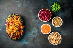 Various legume pasta. Trend healthy food, vegan diet concept. Multi colored legume pasta with raw beans. Beans, chickpeas, green peas, lentils. Copy space top stock image