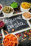Various legume pasta. Trend healthy food, vegan diet concept. Multi colored legume pasta with raw beans. Beans, chickpeas, green peas, lentils. Copy space top stock photos