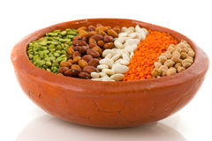 Various legumes. In earthenware brown crockery isolated iver white Stock Photo