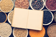 Various legumes and blank recipe book Royalty Free Stock Photo