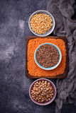 Various legumes. Chickpeas, red lentils, black lentils and  yell Stock Photography