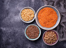 Various legumes. Chickpeas, red lentils, black lentils and  yell Stock Photos