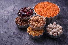 Various legumes. Chickpeas, red lentils, black lentils, yellow p. Eas and beans. Selective focus Stock Photos