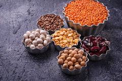 Various legumes. Chickpeas, red lentils, black lentils, yellow p. Eas and beans. Selective focus royalty free stock image