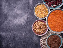 Various legumes. Chickpeas, red lentils, black lentils, yellow p Stock Photography