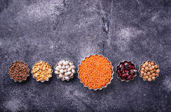 Various legumes. Chickpeas, red lentils, black lentils, yellow p Royalty Free Stock Photos