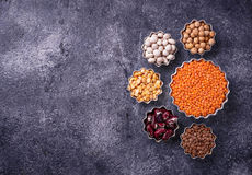 Various legumes. Chickpeas, red lentils, black lentils, yellow p Stock Photo