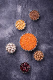 Various legumes. Chickpeas, red lentils, black lentils, yellow p Stock Images