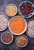 Various legumes. Chickpeas, red lentils, black lentils, yellow p Royalty Free Stock Photo
