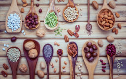 Various legumes and different kinds of nutshells in spoons. Waln Stock Photography