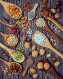 Various legumes and different kinds of nutshells in spoons. Waln Stock Image