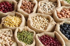 Various of legumes in sack bag stock photo